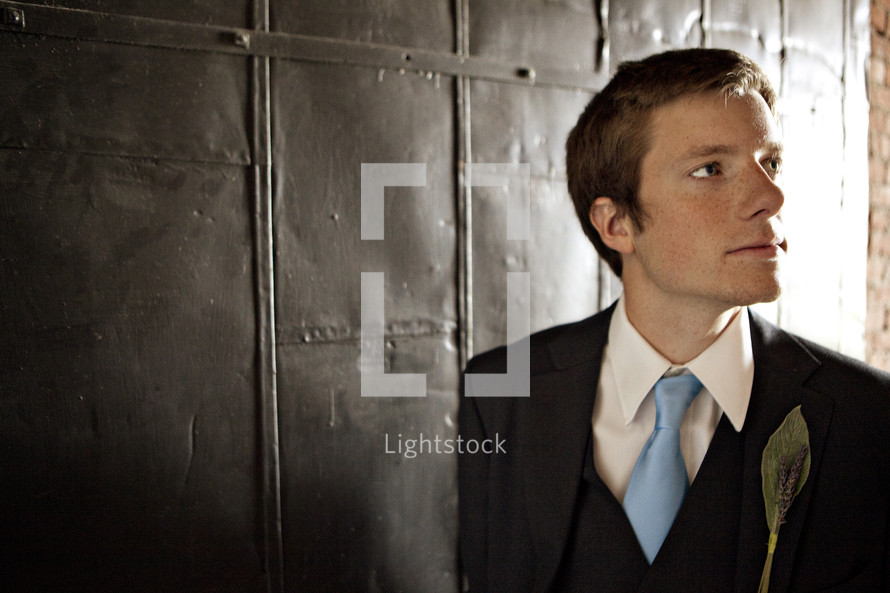 A groom looking to his left