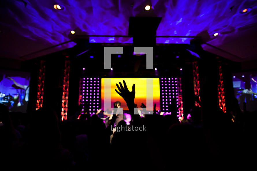 Church service worshipping hands raised lifted