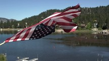 American flag waving over a lake