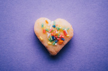 heart shaped cookie with sprinkles