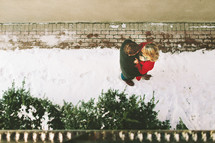 overhead picture of a couple standing in snow