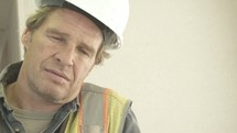 exhausted construction worker