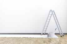 ladder, tarp, wood floor, paint buckets, paint, wall, paint brushes, renovations, home improvements