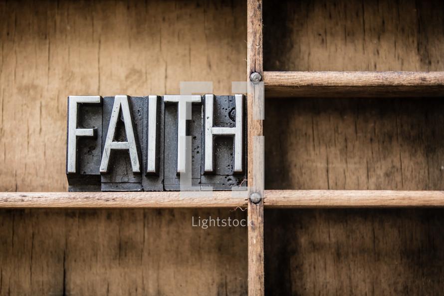 word faith on a bookshelf