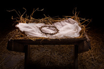 crown of thorns in a manger