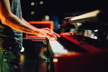Guy playing a digital piano