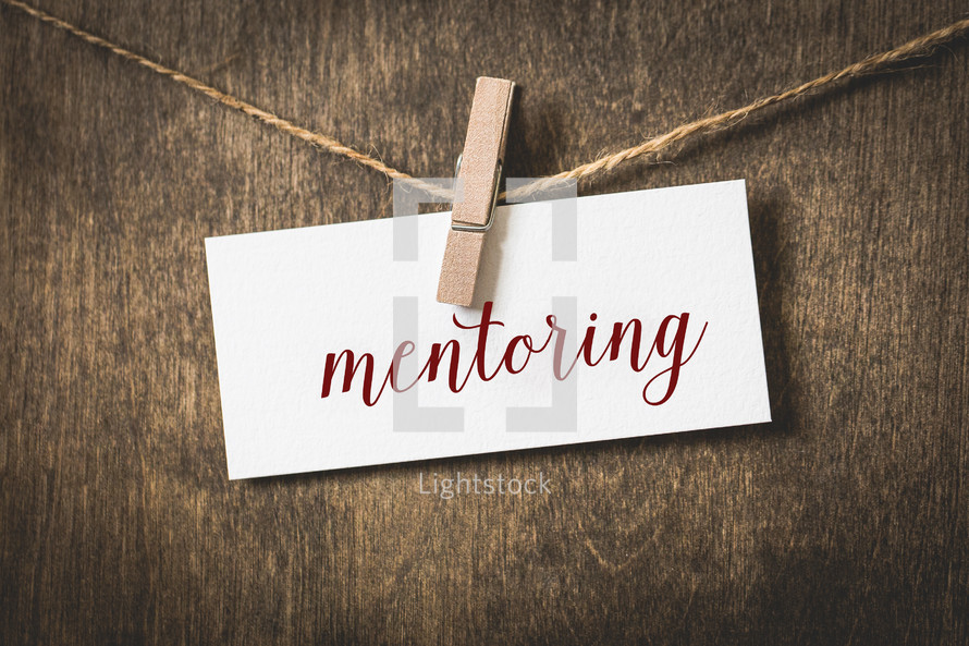 word mentoring on card stock hanging on twine by a clothespin