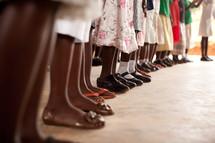 row of feet of school children in Africa