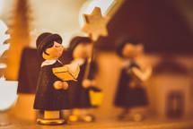 Christmas caroling figurines