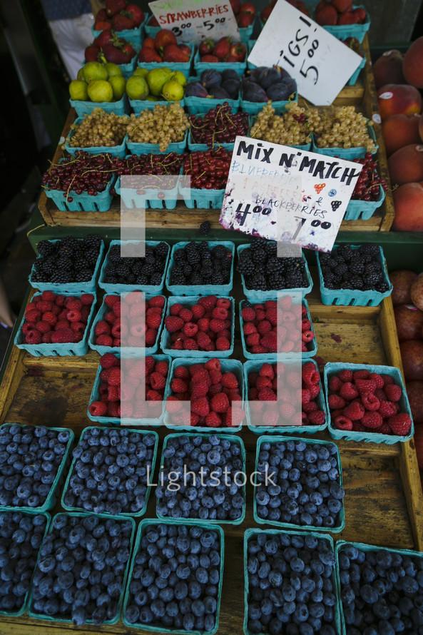 pints of fruit in a market