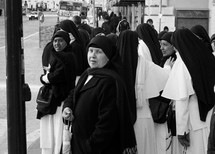 nuns walking down a street in Rome