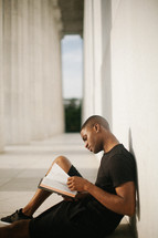 an African American man reading a Bible
