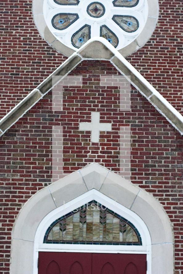 cross above a church entrance