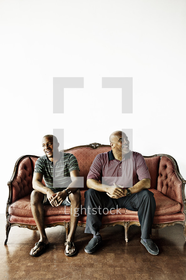 Father and son sitting on a couch
