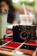 Camera on a cafe table.
