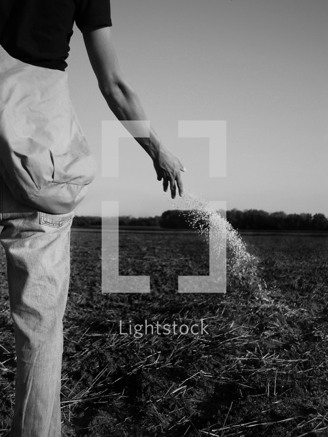 farmer tossing seed