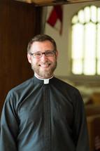 smiling pastor