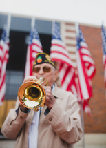 Veteran playing a trumpet to honor fallen soldiers