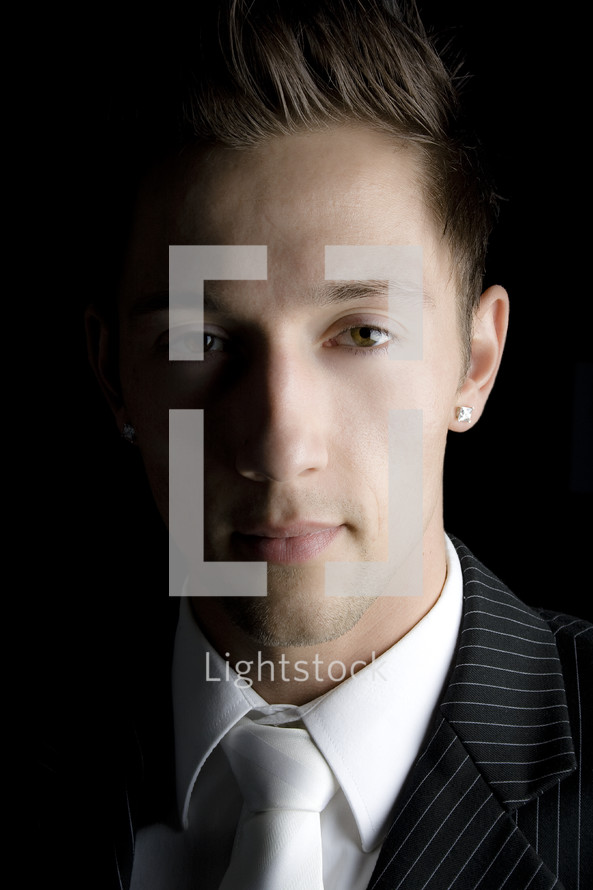 John Successful; man in suit with diamond earring.