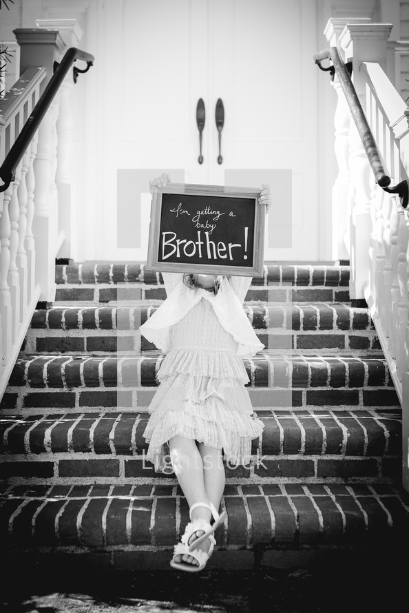 I'm getting a baby brother sign