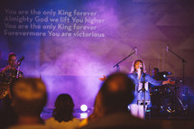 songs on a projection screen during a worship service