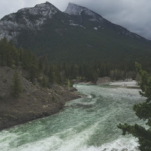 an iPhone capture of this rushing river by mountains