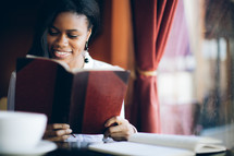 woman reading a journal at a Bible study