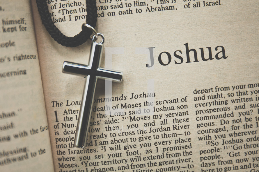 Joshua and a cross necklace