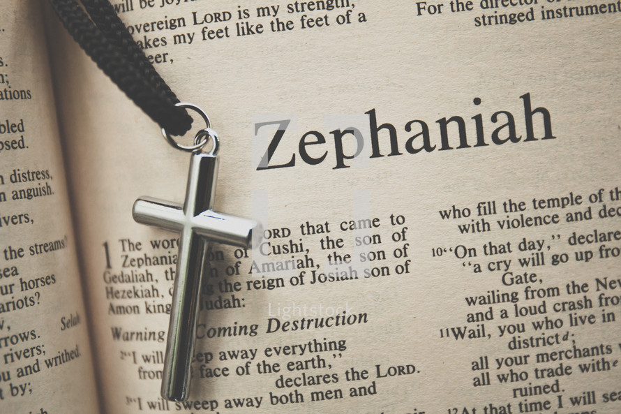 Zephaniah and a cross necklace
