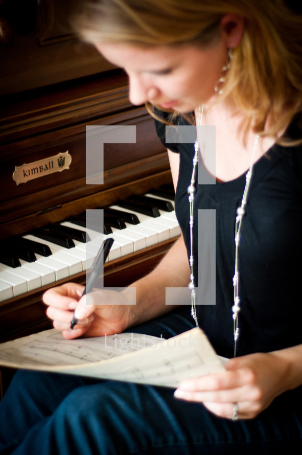 woman writing music