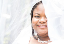 face of an African American bride under her veil
