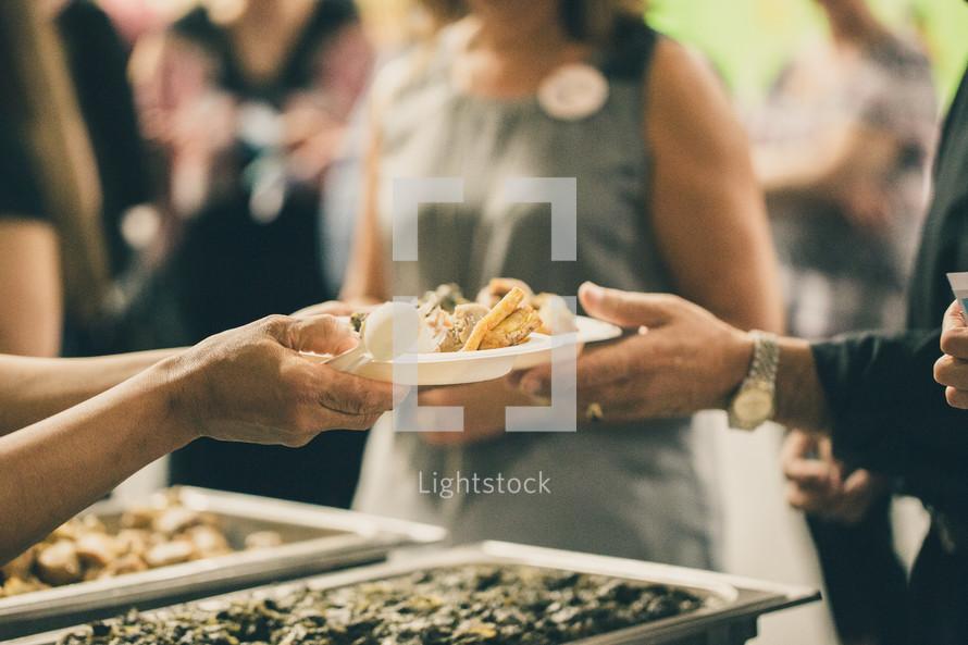 serving food at a buffet