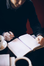 man reading from a Bible at a coffee house during a Bible study