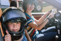 a young teen learning to drive wearing helmets