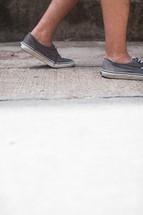 sneakers on a sidewalk