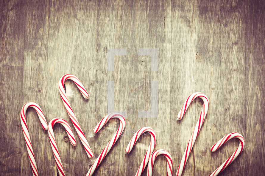 candy canes on a wood background