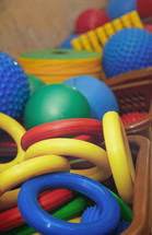 Rubber rings and balls at playground. Close-up photo