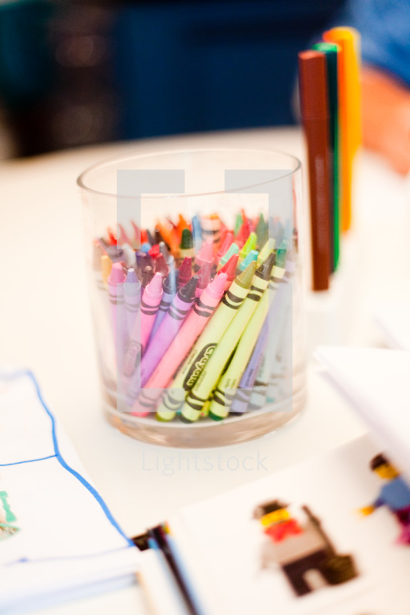 crayons in a cup on a table