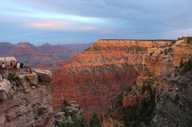 tourists viewing a canyon