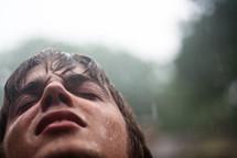 rain falling on a man's face