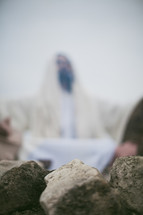 blurry image of Jesus in prayer