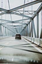 cars crossing a bridge