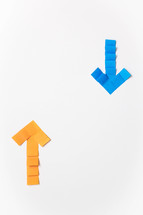 A yellow arrow pointing up and a blue arrow pointing down on a white background.