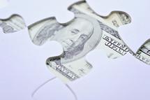 cash under a puzzle