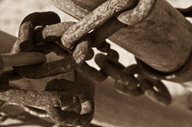 Close-up of  chains wrapped around a pole.