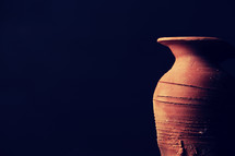 handmade pottery on black background.