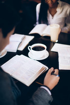 group reading from Bibles at a Bible study