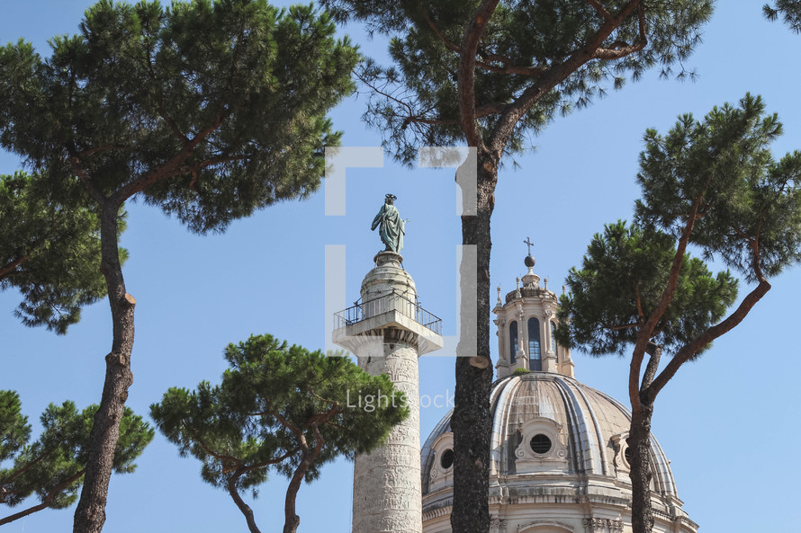 trees and dome on an old cathedral in Italy