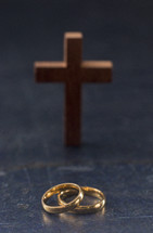 Set of gold wedding rings and cross