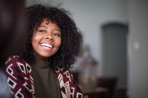 A smiling young woman.